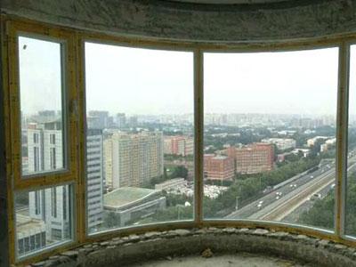 朝阳珠江绿洲坚美断桥铝70系列热弯圆弧封阳台换窗户