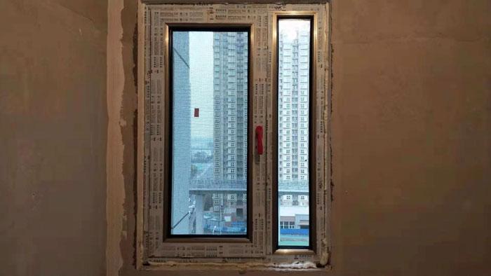 东城区鼓楼外大街忠旺断桥铝70系列香槟色门窗安装